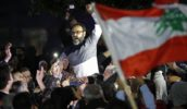 Lebanese actor Ziad Itani being carried after his release in 2018. (AP Photo | Hussein Malla)
